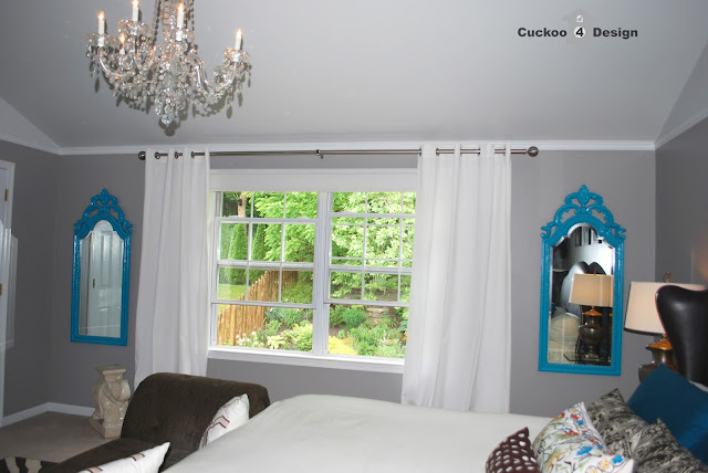 turquoise mirrors flanking bedroom window