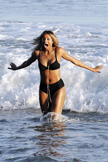 Ciara splashing in the water and wearing a hot two piece bikini