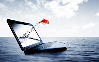 Pez saltando de una laptop hacia el mar - Imaginación | Banco de ...
