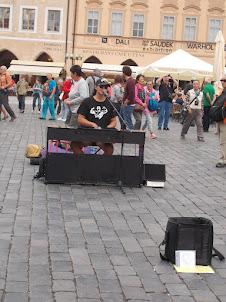 "Organist performing at ""Prague Old Town Square""."