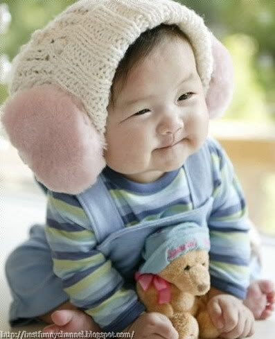 Cute baby and toy.