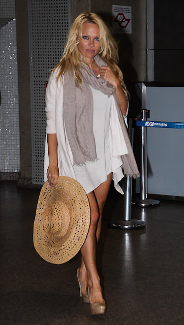 957467676 pm4 122 581lo Pamela Anderson Arriving at Sao Paulo Airport in Brazil [July 27, 2011 ]
