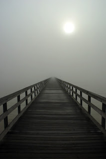 wooden bridge in the fog
