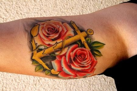 Big beautiful anchor with red roses tattoo on arm