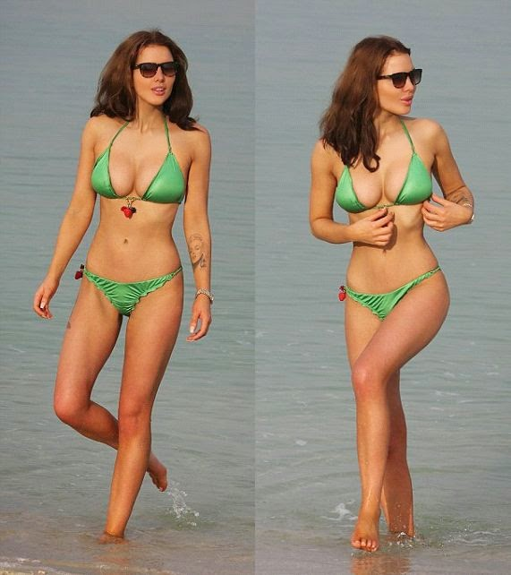 The British beauty didn't wanted to resist her diamond motion to always showing a better value during her down time at the beach in Dubai on Friday, May 23, 2014.