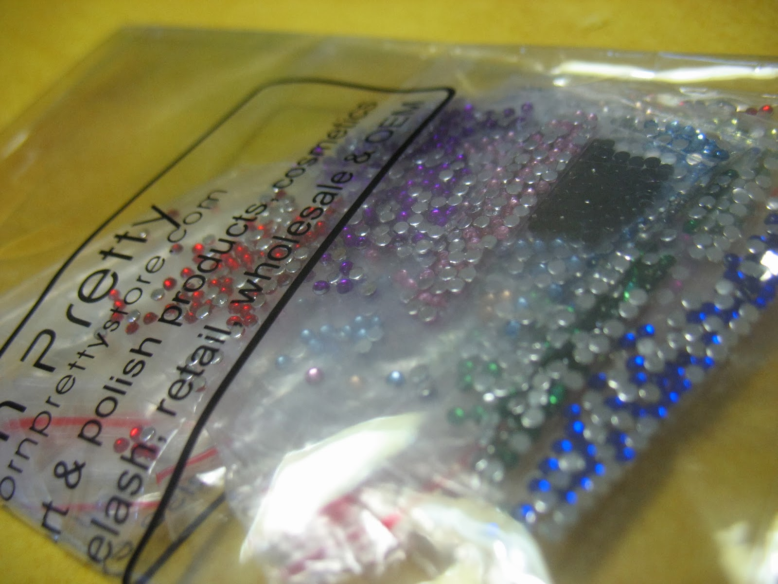 http://www.bornprettystore.com/100pcs-15mm-colorful-rhinestone-acrylic-nail-colors-p-4995.html