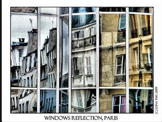 fractured image of buildings reflected in multiple windows on a another building