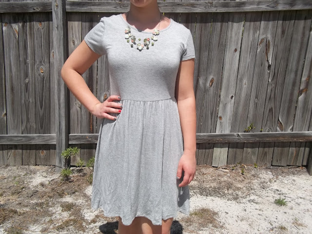 grey jersey dress green and peach statement necklace black bow sandals