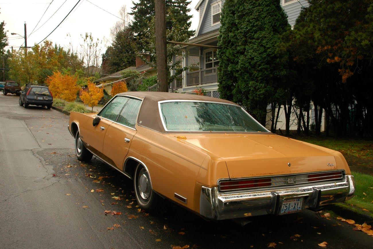 old parked cars   1976 chrysler newport custom