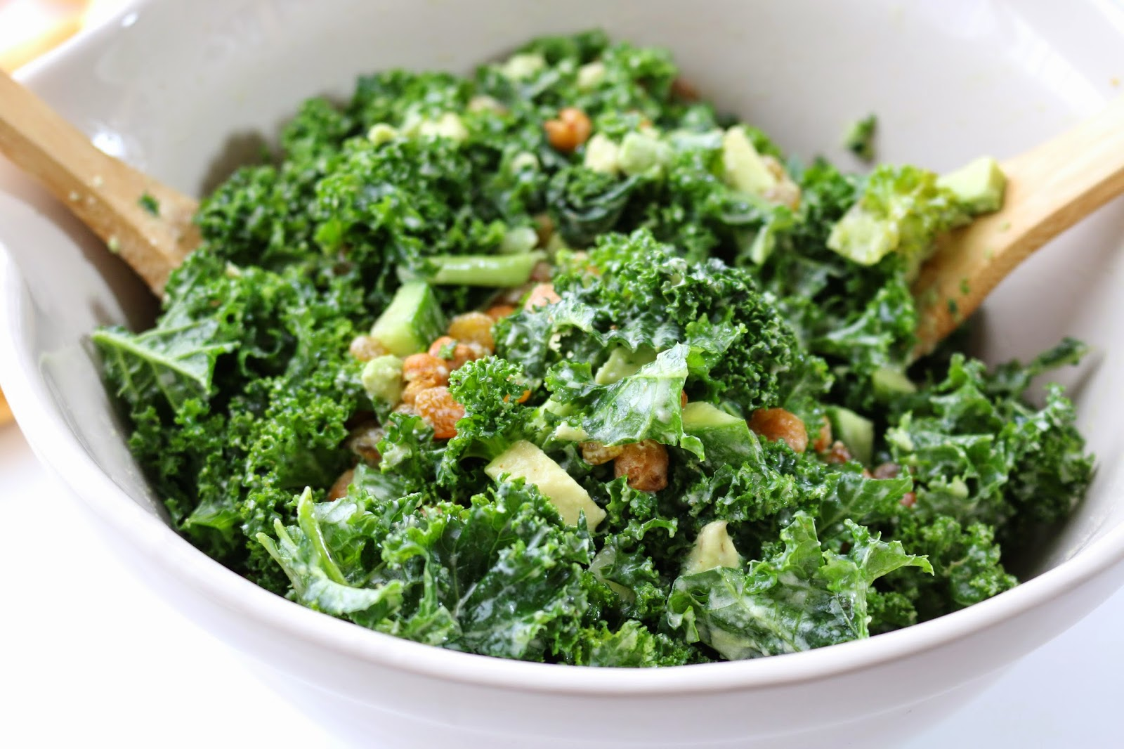 Golden Kale Tahini Salad: This salad combines silky kale greens with the creamy tahini dressing, spicy roasted garbanzo beans and sweet golden raisins