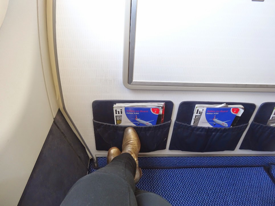 British Airways Legroom on Business Class in my Golden Russell and Bromley boots