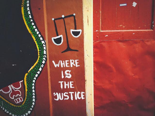 Street Art of Yogyakarta along Jalan Sosrowijayan- Where is the justice?
