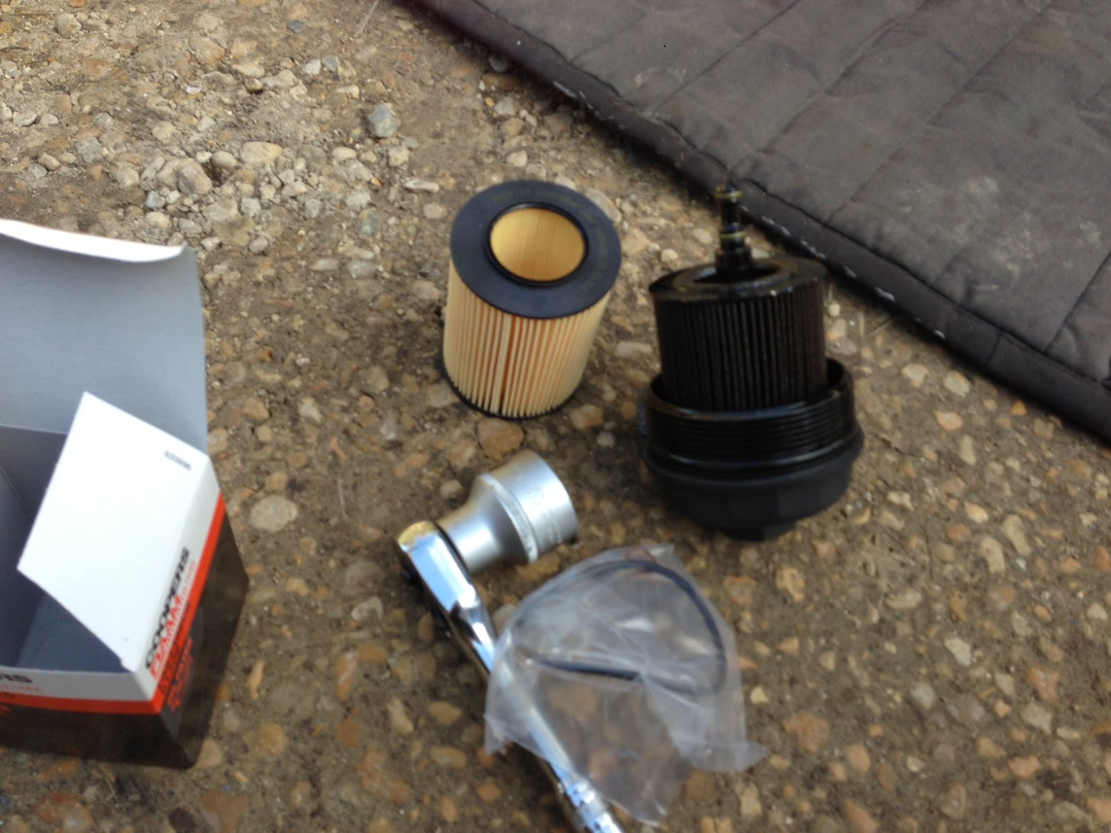 New and old oil filters with 36mm socket to undo the cartridge