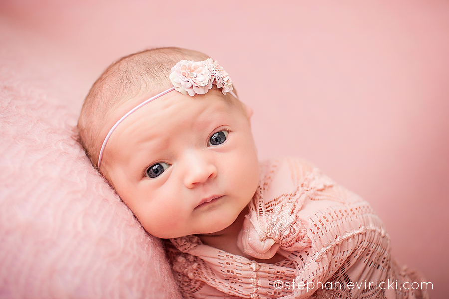 With me taking her pictures but the beauty of her being so alert during the beginning of her session is that i was able to capture this amazing image