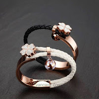 Fashion Four-leaf Clover Woven Leather Titanium Steel With Lovely Bell Charm Women's Bracelet
