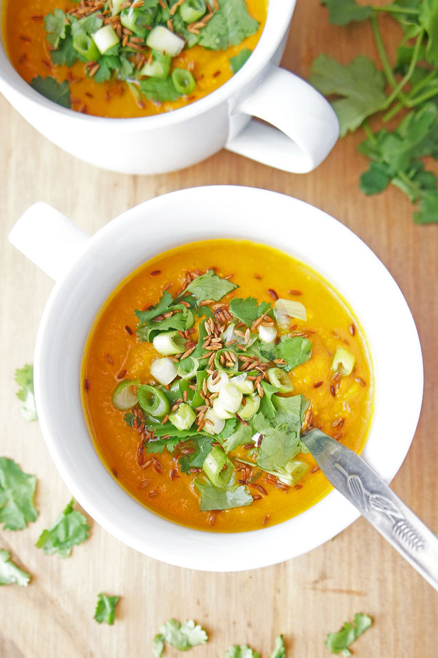 A mild, aromatic curried sweet potato and carrot soup that is creamy yet dairy-free. It is vegan, gluten-free and paleo friendly | The Road to Less Cake | #soup #vegan #paleo #glutenfree #dairyfree #healthy