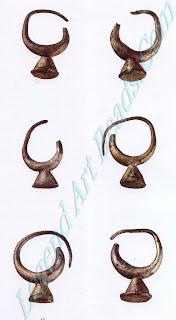 This assortment of earrings was part of the burial gifts found in a pottery sarcophagus in Assur, the original capital of ancient Assyria. The earrings have a crescent shape with a soldered cone pendant.