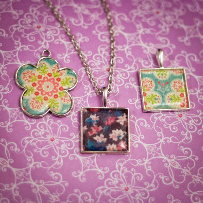three epoxy sticker pendants