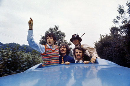 The Beatles look out of the Magical Mystery Tour coach skylight.  On location in the West Country, England.  September 1967