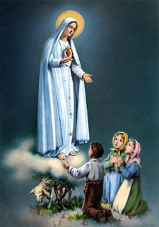 Statue of Mother Mary and her immaculate heart Christian image. she blessing children bible photo