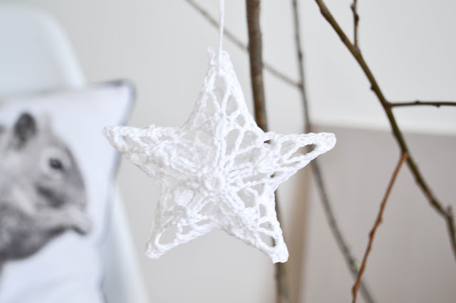 scandinavian style branch with pastel ornaments for Christmas