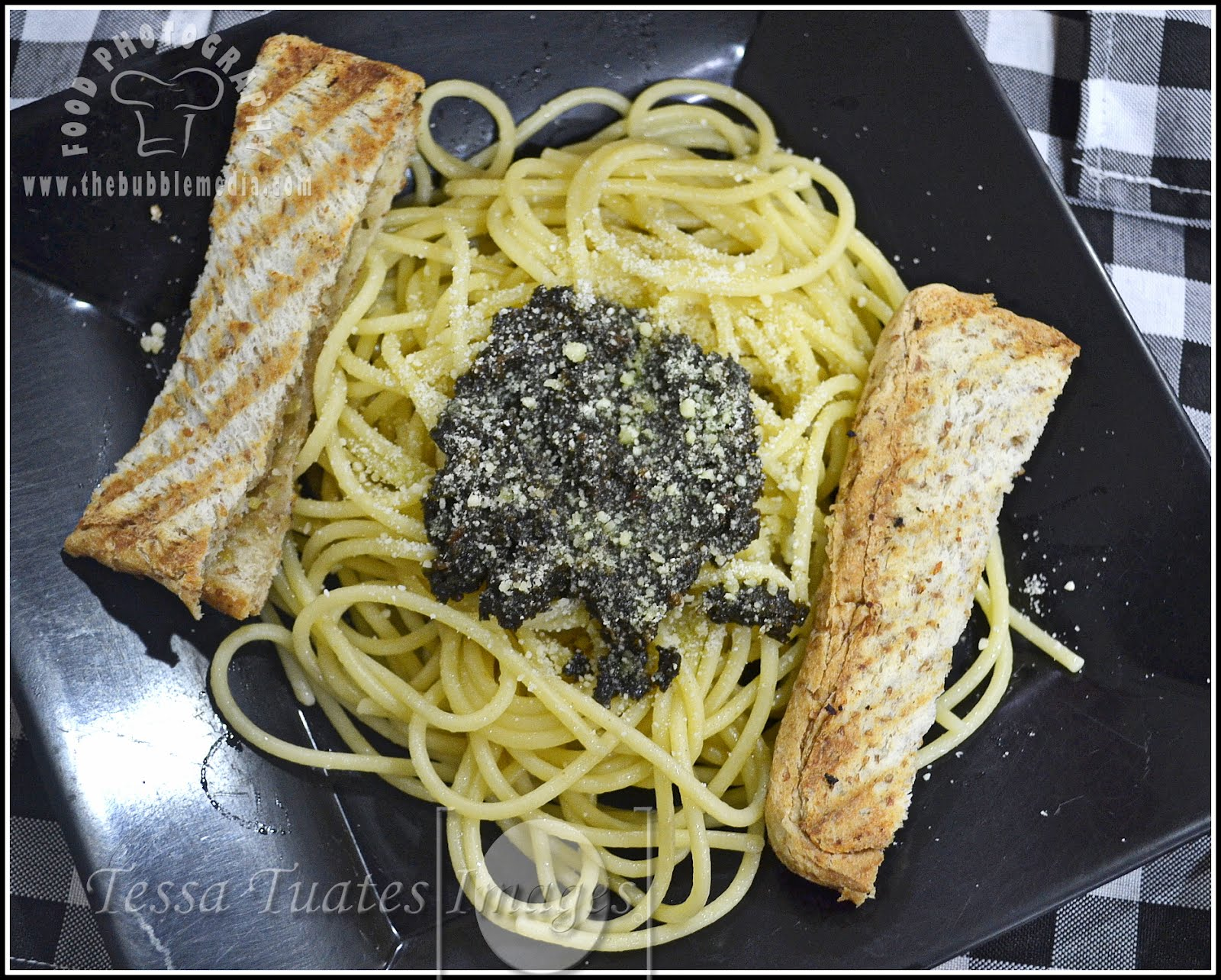 Pesto,  Fresh ground basil leaves and garlic in olive oil. http://www.thebubblemedia.com