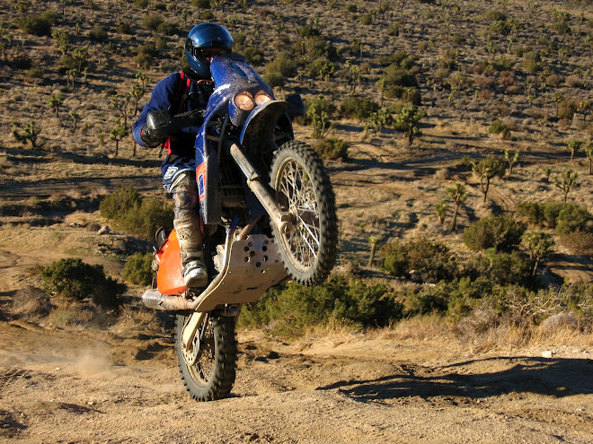 My bro.  Riding style, but no fashion style with that street helmet.  California desert.  KTM 660.