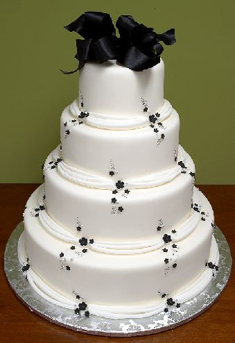 wedding cake with chocolate black at the top