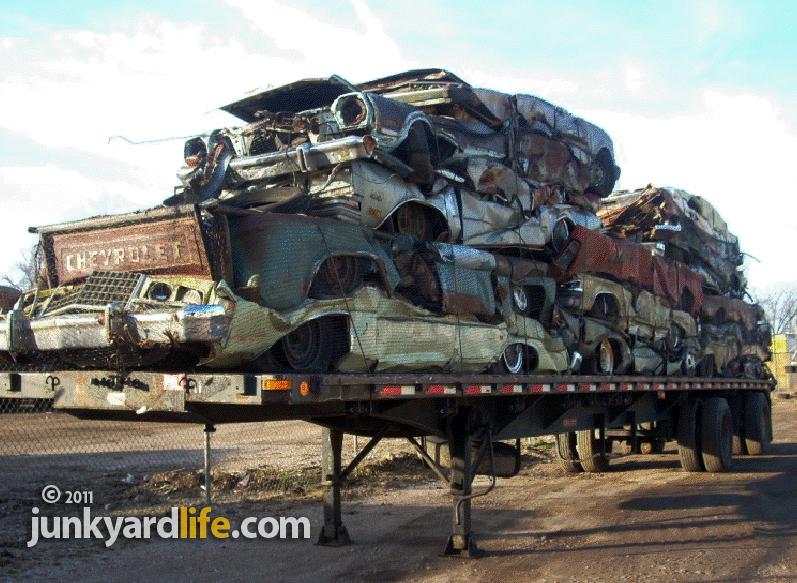 Cars Getting Crushed At Junkyard