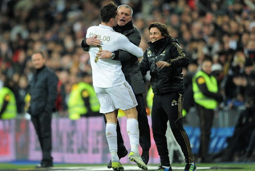 Cristiano Ronaldo celebrates his hat-trick with coach José Mourinho