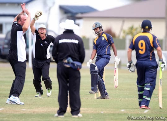 L-R: Jake Chalmers, bowler, Scott Shaw, wicket-keeper, Central Hawke's Bay. Shaw caught Rokon Al Sahariar. At right is Ben Fair, Havelock North - premier cricket at Nelson Park, Napier photograph