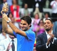 TENIS-Federer y Serena Williams reinan en Madrid