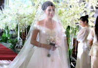 Katerina walks down the aisle