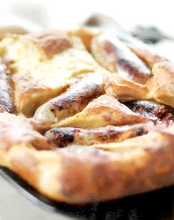 toad in the hole, a classic dish of sausages cooked in a yorkshire pudding batter served cut into sections