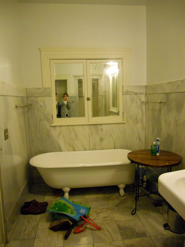 The tub which is disappearing, and the location of the new vanity  title=