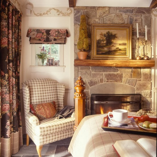 A cozy fireplace the focal point of the room for English cottage bedroom