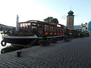 Plush floating restaurant ships on Vltava river in Prague.