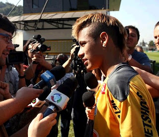 Neymar attends the press conference on training field