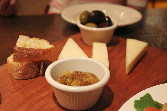 Mixed olives and imported cheeses at Piattini Wine Cafe