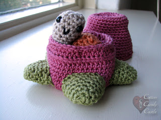 Amigurumi snail in his strawberry home