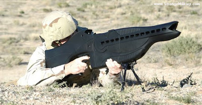 soldier firing future laser gun weapon picture