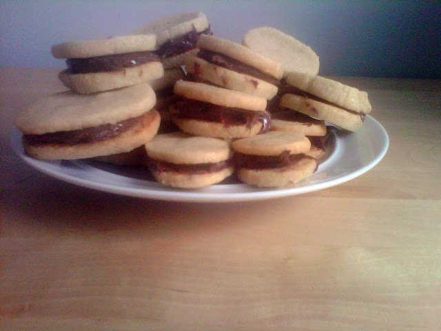 ... & Pink Grapefruit: Almond Shortbread Nutella Sandwich Cookies