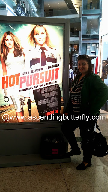 Lifestyle Editor Tracy Iglesias of Ascending Butterfly in front of Hot Pursuit Movie Poster