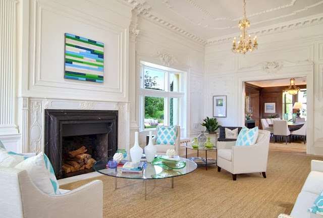 Living room in a historic San Francisco mansion with decorative moldings & high ceilings