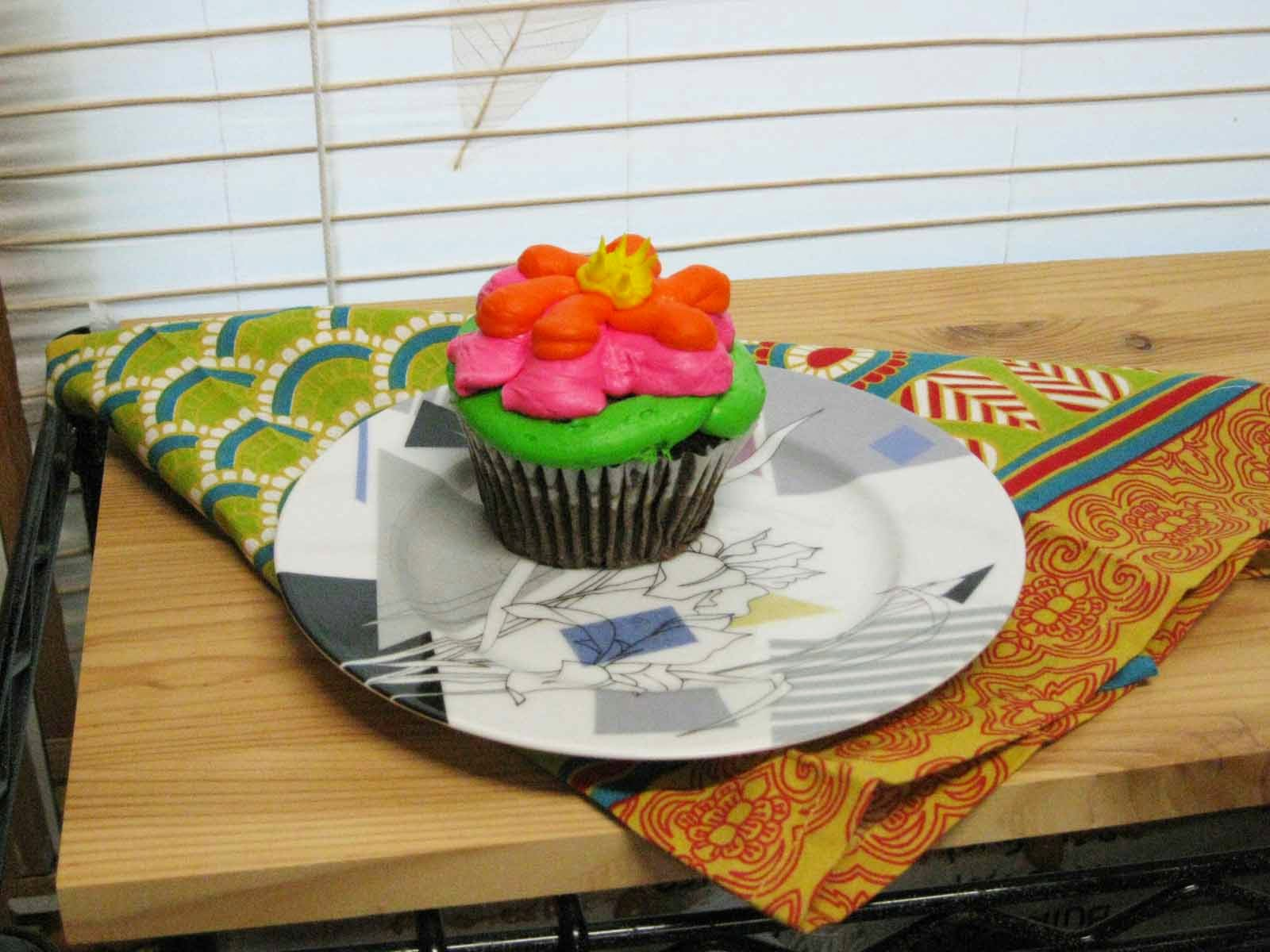 colorful cupcake with patterned napkin and plate