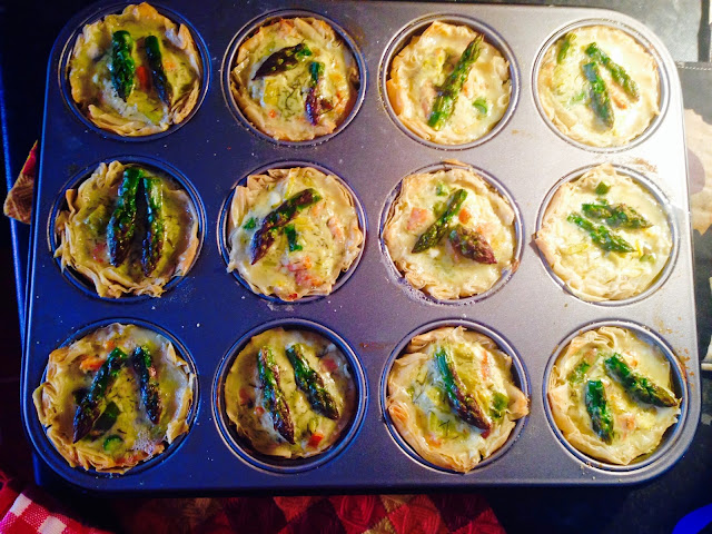 A tray of smoked salmon, feta and asparagus fillo tartlets