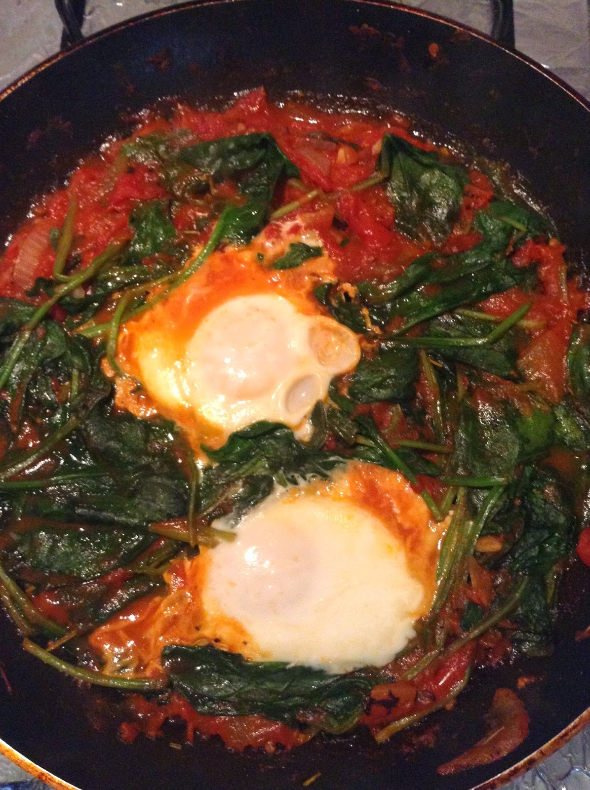 Fully cooked Spinach Egg Shashuka in a saucepan