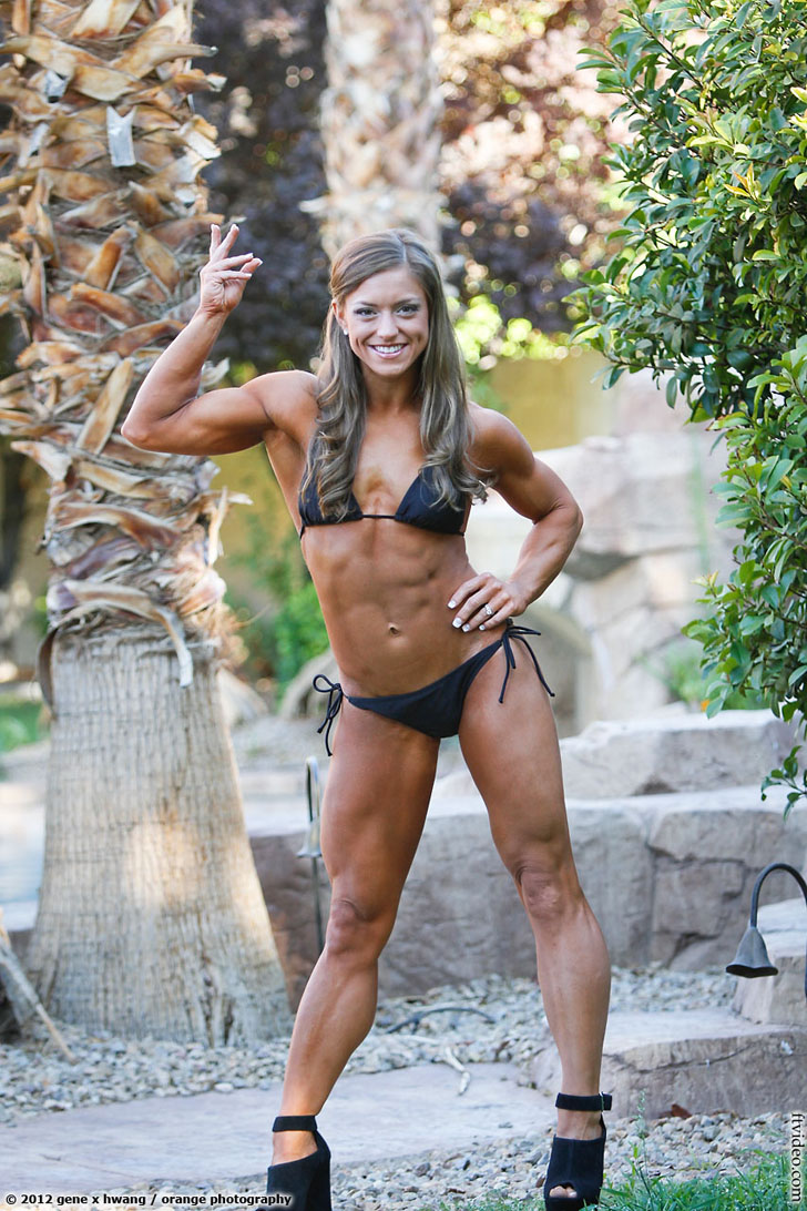 Holland Canter Flexing A Bicep And Muscular Legs In A Bikini
