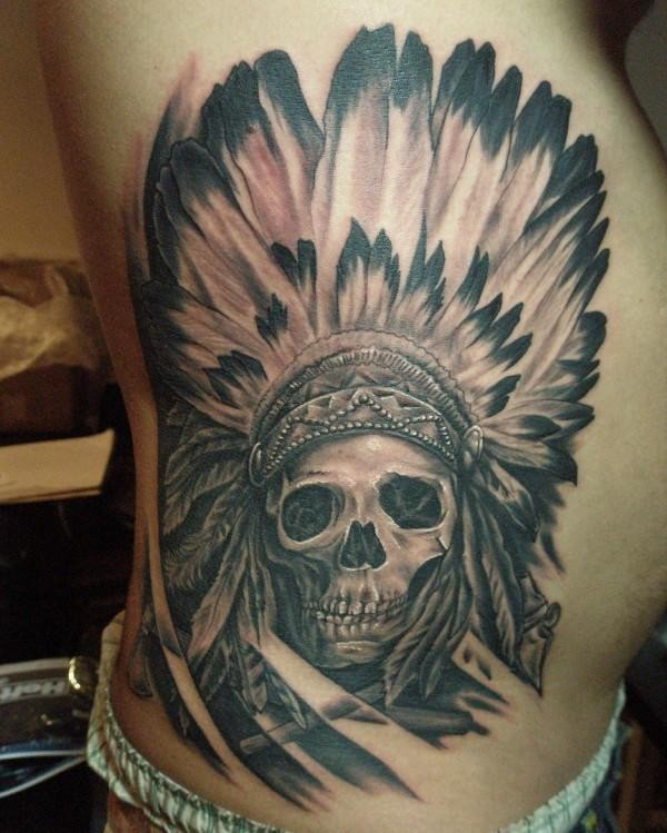 Skull in an indian headdress tattoo on ribs