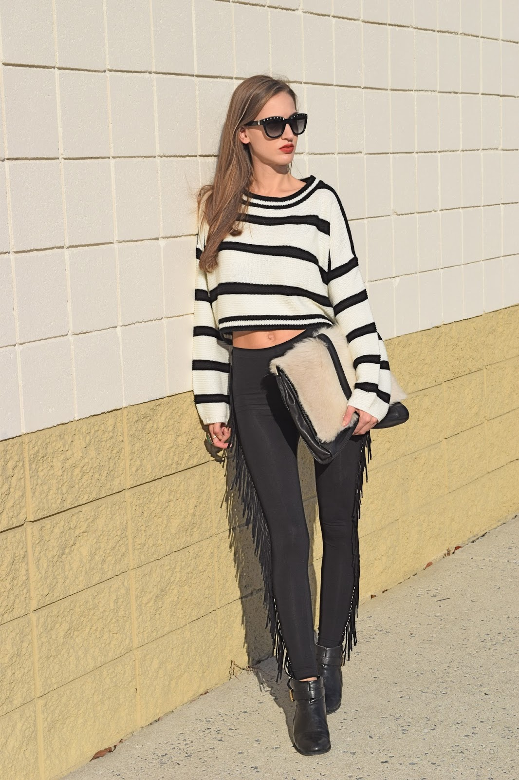 Wearing Yoins black and white striped crop top sweater, Top Shop black fringe leggings, Valentino Rockstud sunglasses
